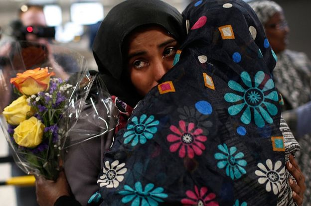 A Yemeni woman hugs her mother at a Virginia airport in February after courts granted a stay on Trump's order