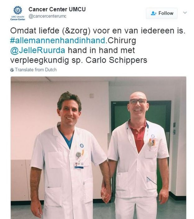 Two medical staff hold hands at an Utrecht hospital: