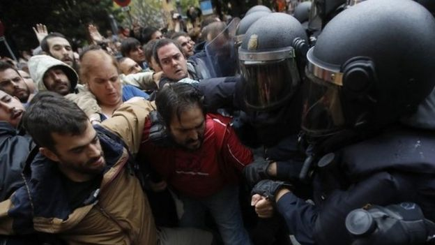 Catalan people who gathered outside the Ramon Llull school clash with Spanish National riot policemen in Barcelona