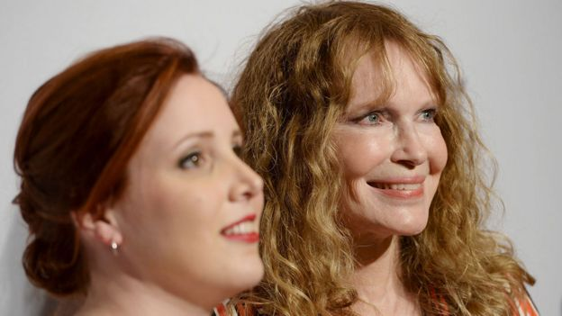 Dylan Farrow with mother Mia