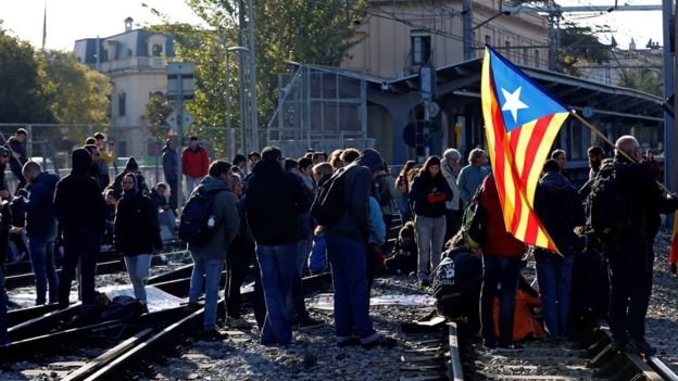 Protesters block a track in in Sant Cugat del Valles, Spain