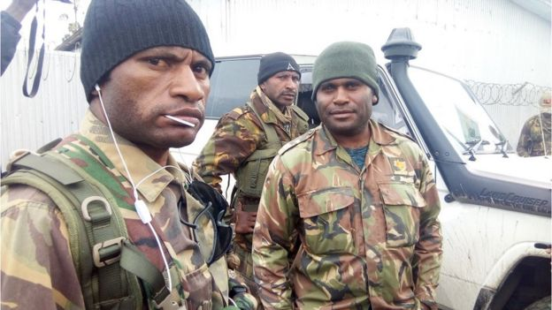 PNG troops wait to be sent to the quake zone
