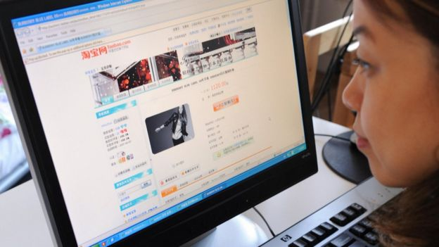 A woman in Beijing shops online at the Taobao website on February 5, 2008.