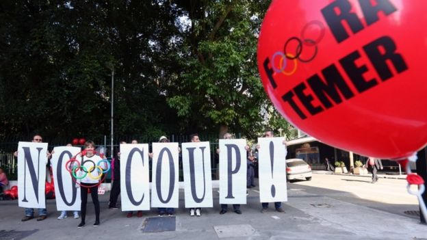 Supporters of suspended Brazilian President Dilma Rousseff protest against the government of interim President Michel Temer before the relay of the Olympic flame at Paulista Avenue in Sao Paulo