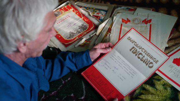 Vladimir Voskresenskiy looking at a document