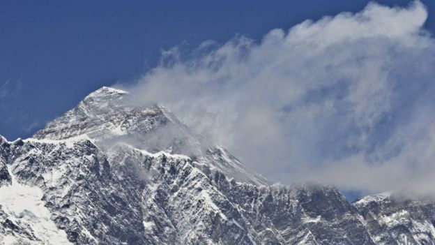 A view of Mount Everest (C-top) towering over the Nupse-Lohtse massif (foreground) from the village of Tembuche in the Khumbu region of northeastern Nepal (file photo)