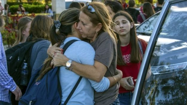 Students are reunited with parents and family after a shooting at Marjory Stoneman Douglas High School in Parkland, Florida.