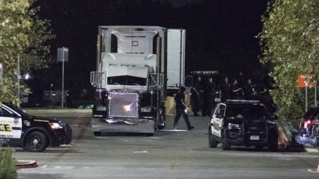 Officials investigate a truck that was found to contain 38 suspected illegal immigrants in San Antonio, Texas, USA, 23 July 2017