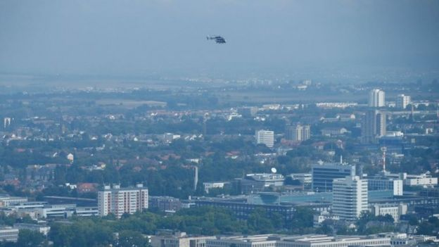 A police helicopter observes the danger zone as about 65,000 people in Frankfurt evacuate part of the city while experts defuse an unexploded British World War Two bomb