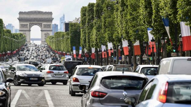 Vehicles on the Champs-Elysees avenue on May 13, 2017 in Paris