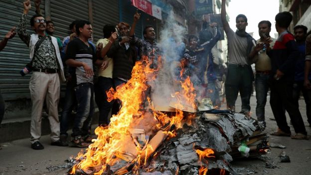 Bangladesh Nationalist Party (BNP) supporters shout slogans as they set fire during a protest in a street in Dhaka, Bangladesh February 8, 2018
