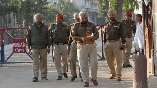 Punjabi police officials at a check post near the ashram of Ashutosh Maharaj at Nurmahal, some 30km from Jalandhar on December 4, 2014.