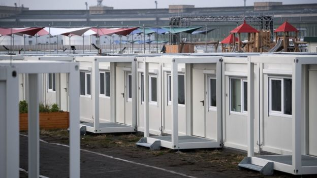 Container homes for asylum seekers are pictured at the Tempelhofer Feld former airport in Berlin, on 1 December, 2017.