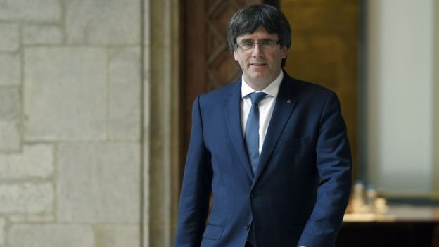 Carles Puigdemont, wearing a suit at Cataln government headquarters