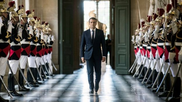 French President Emmanuel Macron walks through the Galerie des Bustes (Busts Gallery) to access the Versailles Palace - 3 July 2017