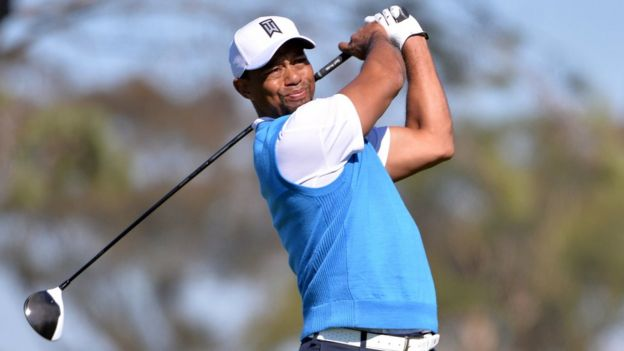 Tiger Woods tees off at Torrey Pines Municipal Golf Course in La Jolla, California January 26, 2017