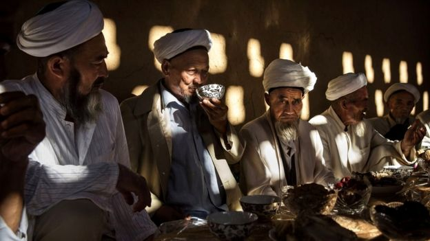 Uyghur men at a festive meal