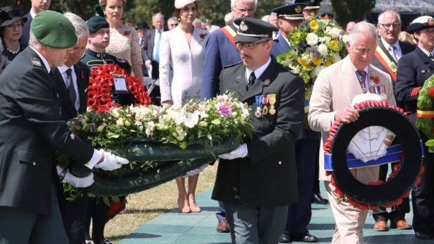 King Philippe of Belgium (second left) and Prince Charles laying floral tributes
