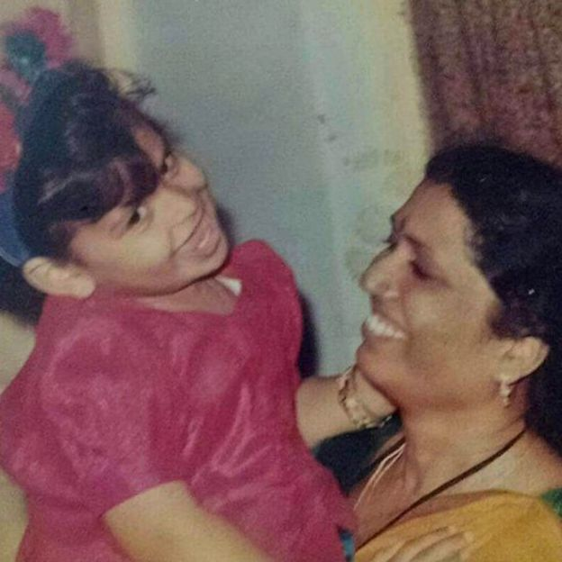 Venkata with her late adoptive mother as a child