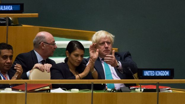 Foreign Secretary Boris Johnson and International Development Secretary Priti Patel were among those watching the PM's speech