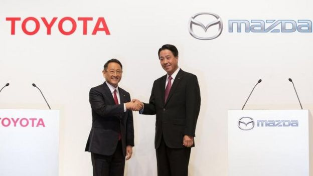 Toyota Motor Corp. President Akio Toyoda (L) and Mazda Motor Corporation President and CEO Masamichi Kogai (R)