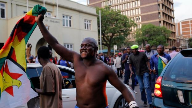 People celebrate in the capital of Zimbabwe.