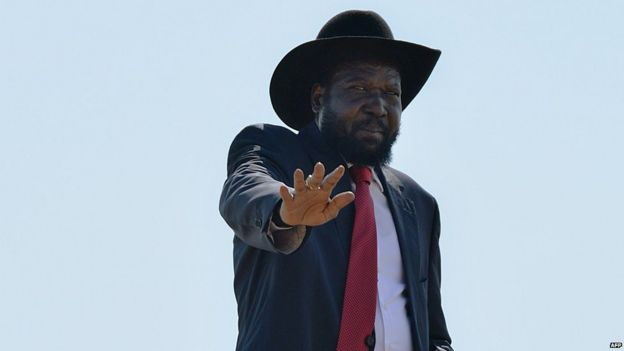 South Sudan President Salva Kiir waves at members of his cabinet as he boards a plane in Juba to attend an African Union (AU) summit in Malabo, Equatorial Guinea, on 25 June 2014