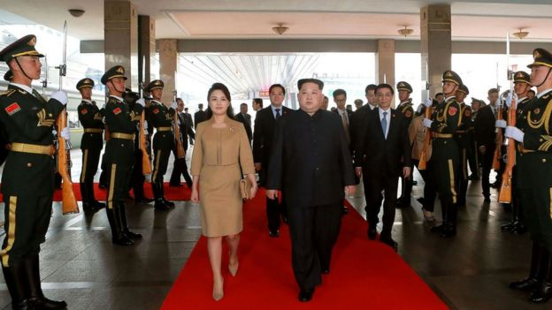 Kim Jon-un and his wife on arrival at Beijing Central Station.