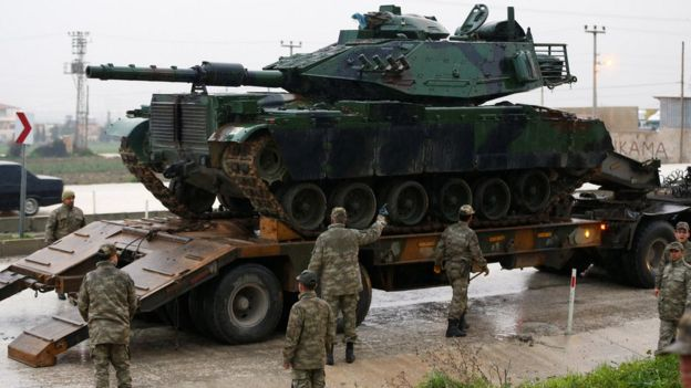 A Turkish military tanks arrives at an army base in the border town of Reyhanli