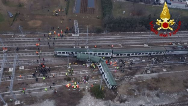 This handout picture released by the Italian Vigili del Fuoco shows firemen working on the site of a train derailment
