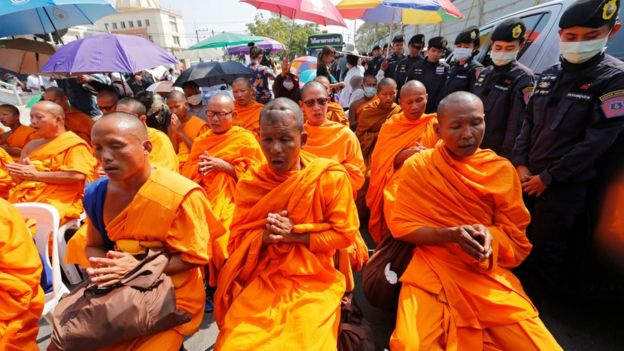 Buddhist monks chant inside Dhammakaya temple while police block access to the place in Pathum Thani province, Thailand 16 February 2017