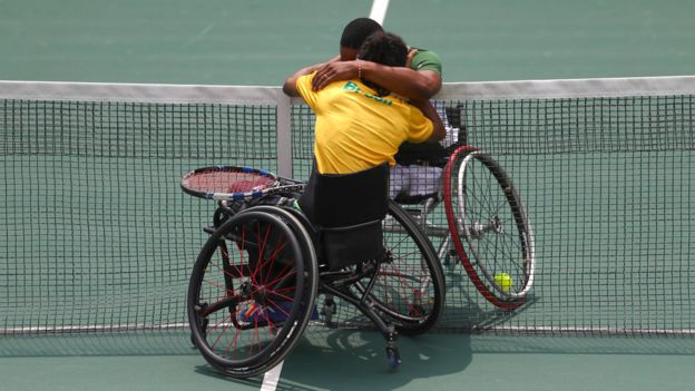 Lucas Sithole of South Africa and Ymanitu Silva of Brazil celebrate together after competing in the wheelchair tennis at central court on day 3 of the Rio 2016 Paralympics on September 10, 2016 in Rio de Janeiro, Brazil.