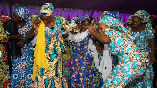 Image shows 'Chibok girls' dancing at a party in Abuja