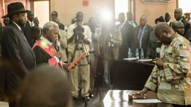 Mr Machar is pictured while being sworn in in the presence of President Salva Kiir