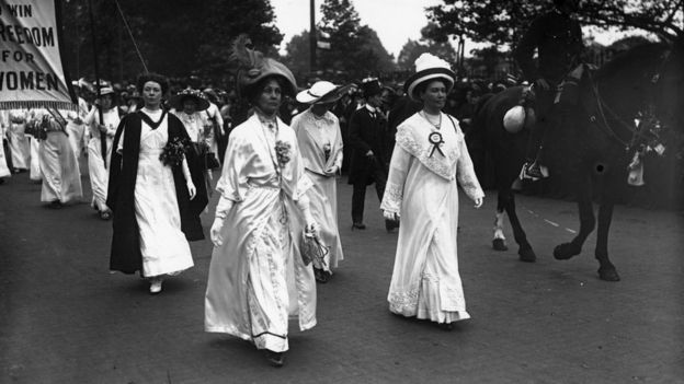 Leading suffragette Emmeline Pankhurst (front left) leads a parade through London, with the protesters all dressed in white on 11 June 1911