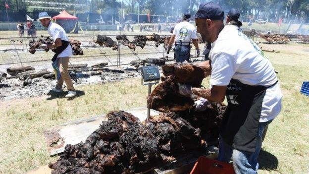 Cooks weigh the beef to reach a total of 16,500 kg, in Rodo Park in Minas, Uruguay, 120 km from Montevideo, in an attempt to break the Guinness record for