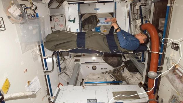 On the ISS, astronauts have to sleep tied to the wall - and they don't have any pillows