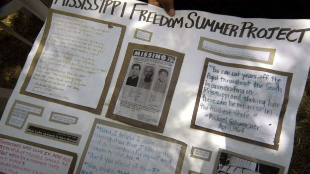 A poster held outside of 2005 trial shows the original missing poster for the men and dedications and quotes for them