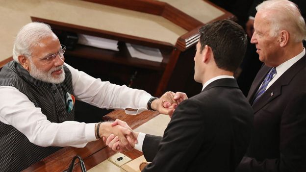 Indian Prime Minister Narendra Modi, (L), shakes hands with House Speaker Paul Ryan (R-WI), (C), and US Vice President Joseph Biden (