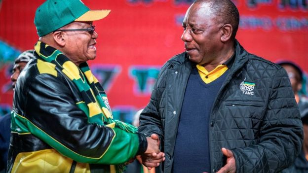 South African President Jacob Zuma (L) and South African Deputy President Cyril Ramaphosa (R) shake hands as they arrive to attend the opening session of the South African ruling party African National Congress (ANC) policy conference on June 30, 2017 in Johannesburg.