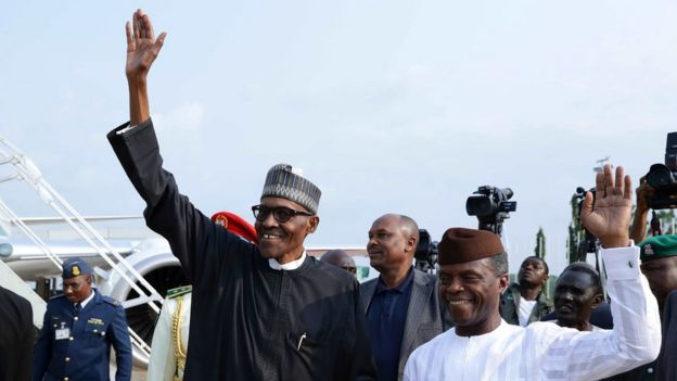 President Buhari and his deputy, Yemi Osinbajo, wave as they arrive in Abuja