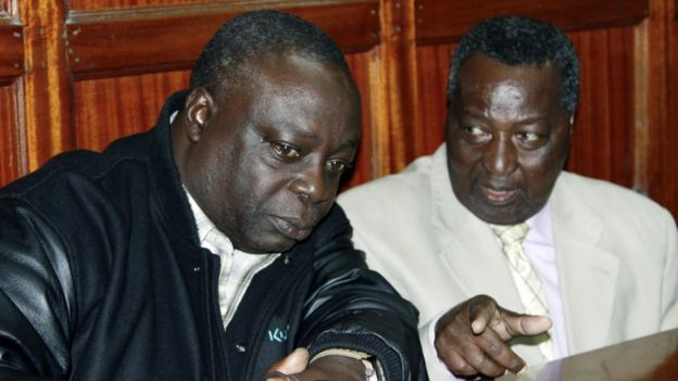 National Olympic Committee of Kenya secretary general Francis K Paul, left, and vice-chairman Pius Ochieng, right, appear at the High Court in Nairobi, Kenya
