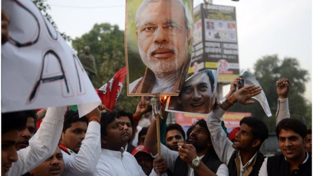 Indian activists from the Samajwadi Party burn a poster bearing the image of Indian Prime Minister Narendra Modi as they shout slogans against central government, and in support of Bollywood actor Amir Khan, who has spoken against what he has called growing intolerance and insecurity in India, in Allahabad on November 26, 2015. AFP PHOTO / SANJAY KANOJIA / AFP / Sanjay Kanojia (Photo credit should read SANJAY KANOJIA/AFP/Getty Images)