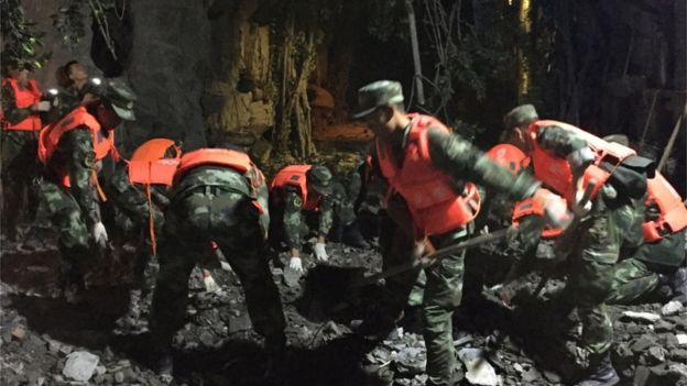 Paramilitary police dig in the rubble in Jiuzhaigou