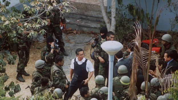 Peruvian President Alberto Fujimori (centre) arrives on the compound of the residence of the Japanese ambassador in Lima 22 April 1997