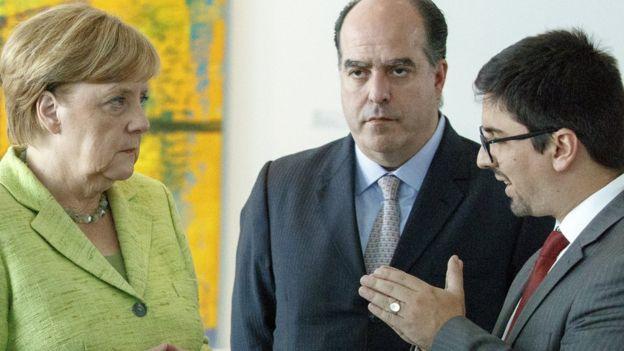 Angela Merkel, Julio Borges y Freddy Guevara.