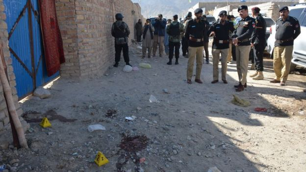 Pakistani police officials gather at the site of an attack by gunmen on a polio vaccination team on the outskirts of Quetta on January 18, 2018