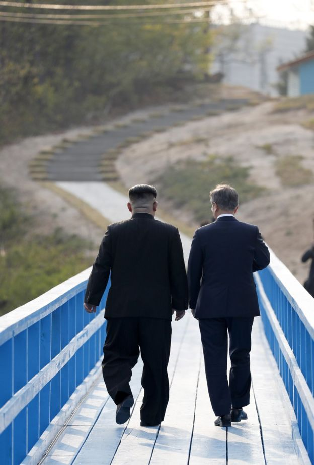 North Korean leader Kim Jong Un (L) and South Korean President Moon Jae-in (R) take a walk on the walk bridge during the Inter-Korean Summit on April 27, 2018 in Panmunjom, South Korea. Kim and Moon meet at the border today for the third-ever Inter-Korean summit talks after the 1945 division of the peninsula, and first since 2007 between then President Roh Moo-hyun of South Korea and Leader Kim Jong-il of North Korea. (Photo by Korea Summit Press Pool/Getty Images)