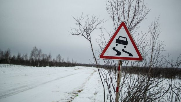 Sign warning of slippery road in Yangutum, Siberia - 2016 pic