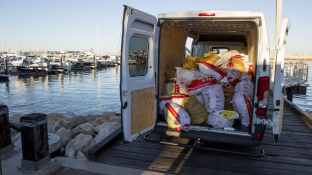 A van containing bags allegedly filled with drugs at a dock in Western Australia